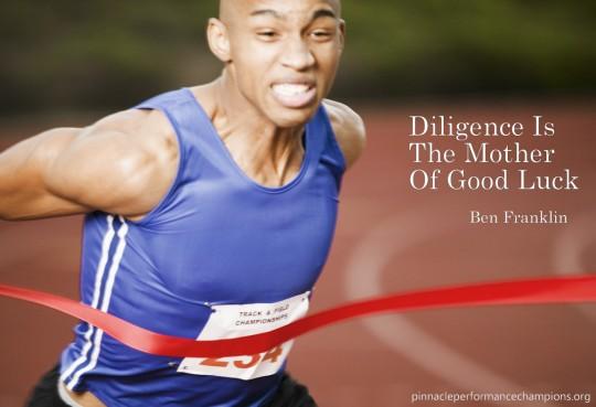 Athlete Running Through Finish Line